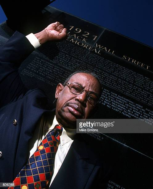 Oklahoma State Representative Don Ross who has been instrumental in bringing the Tulsa Race Riot to national attention poses in front of the Black...