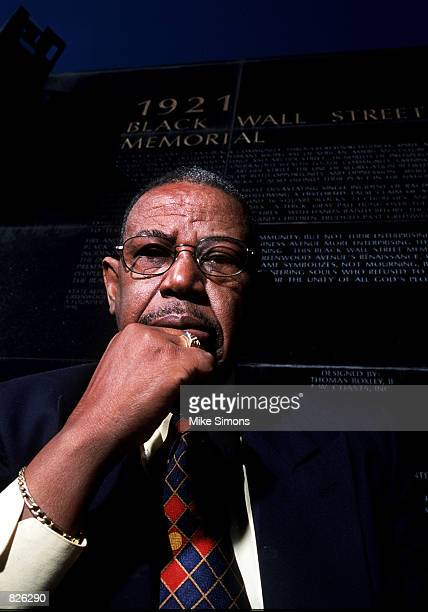 Oklahoma State Representative Don Ross, who has been instrumental in bringing the Tulsa Race Riot to national attention, poses in front of the Black...