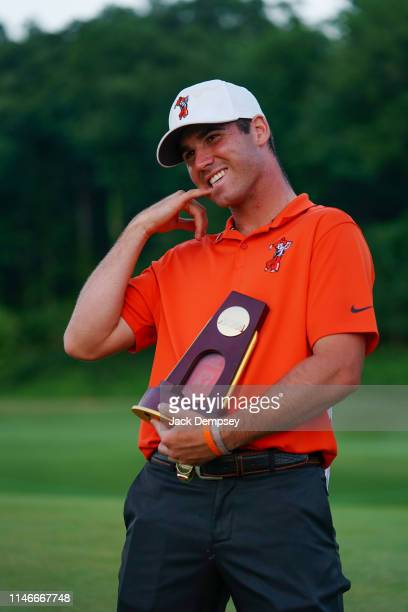 Oklahoma States Matthew Wolff holds the Division I Men's Golf Stroke Play Championship trophy at the Blessings Golf Club on May 27 2019 in...