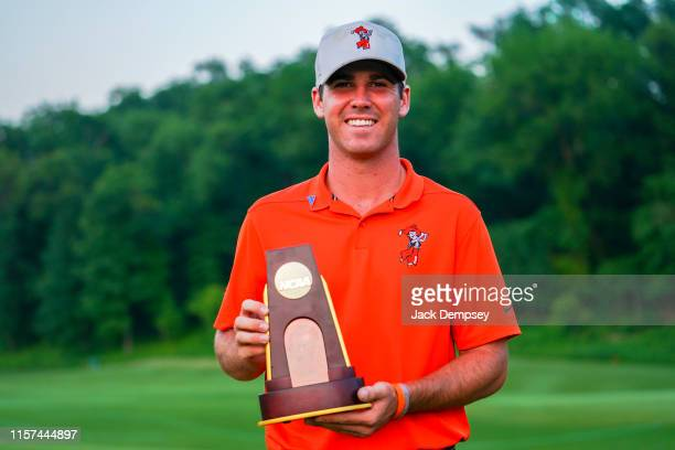 Oklahoma State's Matthew Wolff holds the Division I Men's Golf Stroke Play Championship trophy at the Blessings Golf Club on May 27 2019 in...