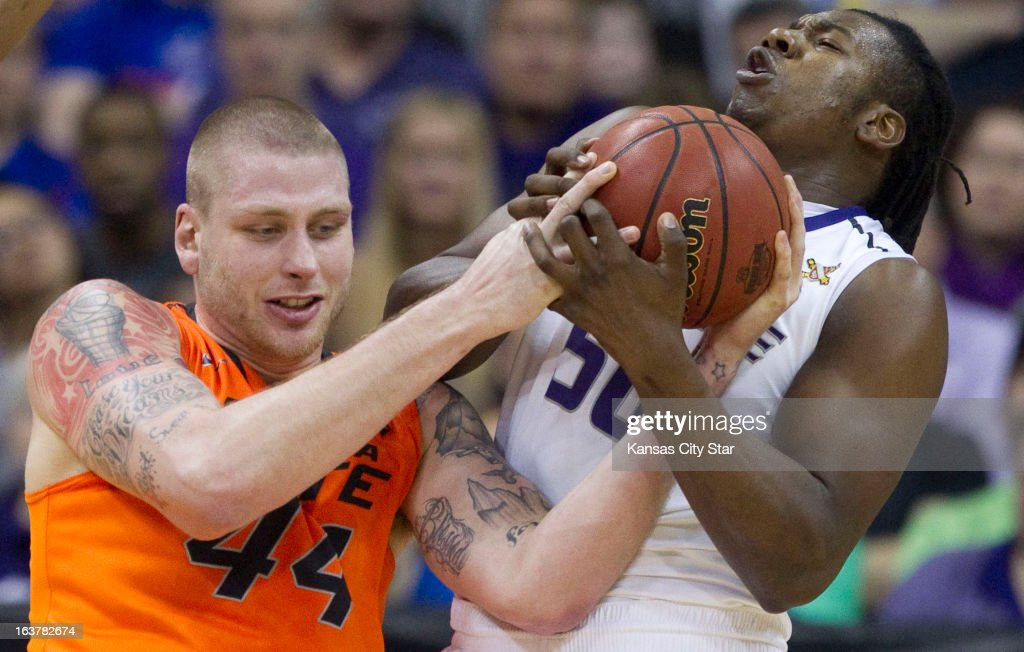 Oklahoma State's Philip Jurick (44) battles for a rebound with Kansas State's D.J. Johnson in the first half in the Big 12 Tournament semifinals at the Sprint Center in Kansas City, Missouri, on Friday, March 15, 2013