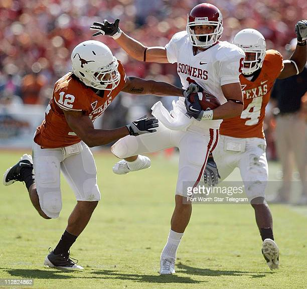 Oklahoma wide receiver Cameron Kenney is knocked out of bounds by Texas safety Earl Thomas in firsthalf action Texas defeated Oklahoma 1613 at the...