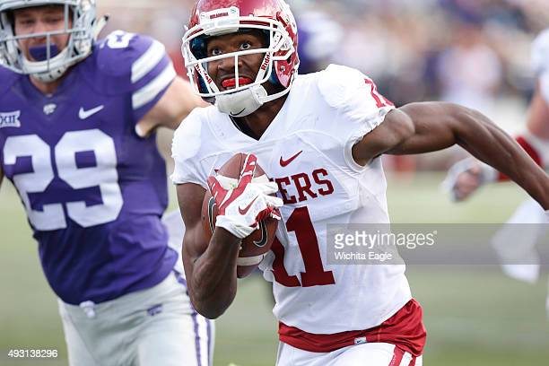 Oklahoma wide receiver Dede Westbrook makes a dash down field for a 36yard gain in the third quarter against Kansas State at Bill Snyder Family...