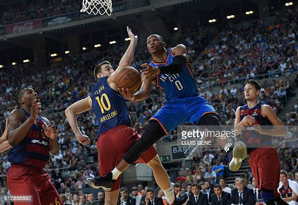 Oklahoma's guard Russell Westbrook vies with Barcelona's forward Victor Claver during the NBA Global Games Europe 2016 basketball match between FC...