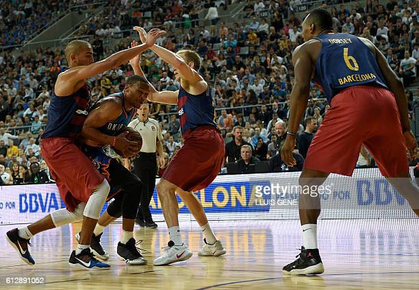 Oklahoma's guard Russell Westbrook vies with Barcelona's stefan Peno and Barcelona's US guard Brad Oleson during the NBA Global Games Europe 2016...