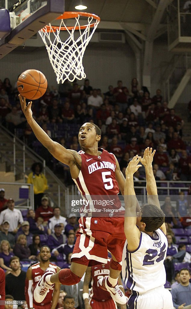 Oklahoma's Je'lon Hornbeak (5) goes over Texas Christian's Chris Zurcher (25) for a shot in the second half at Daniel-Meyer Coliseum in Fort Worth, Texas, on Saturday, March 9, 2013. TCU prevailed, 70-67.