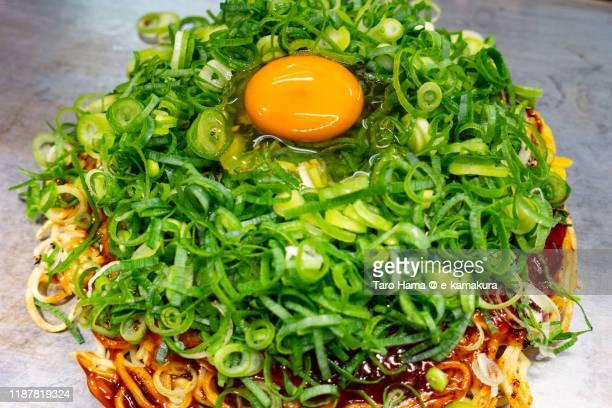 okonomiyaki in hiroshima city of japan - okonomiyaki stock pictures, royalty-free photos & images