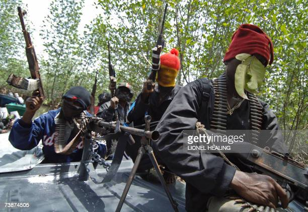 Masked Ateke Tom militants hold their guns as they arrive at their camp 13 April 2007 in Okrika Rivers State Ateke Tom is the leader of the Niger...