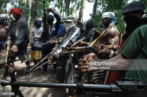Masked Ateke Tom militants stand with guns at their camp 13 April 2007 in Okrika Rivers State Ateke Tom is the leader of the Niger Delta Vigilante an...