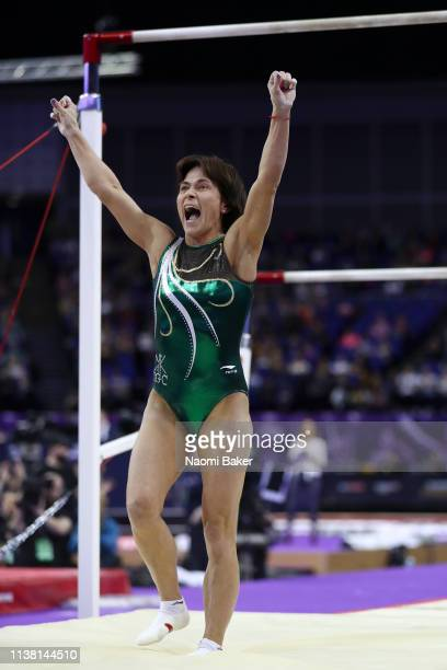 Oksana Chusovitina celebrates after performing on the uneven bars during the Superstars of Gymnastics at The O2 Arena on March 23, 2019 in London,...