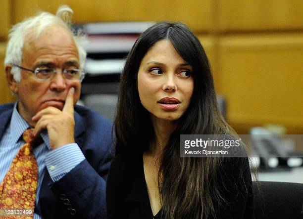 Oksana Grigorieva looks at her former boyfriend actor Mel Gibson during a hearing in a Los Angeles Superior Court to finalize financial issues on...