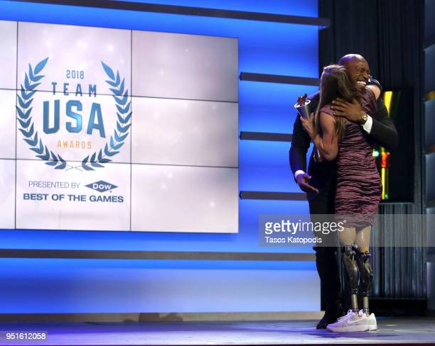 Oksana Masters accepts the Female Paralympic Athlete of the Games award from Vernon Davis during the Team USA Awards at the Duke Ellington School of...
