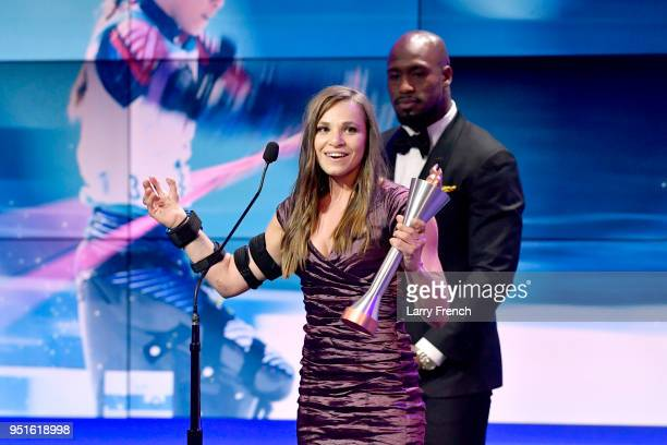 Oksana Masters accepts the Female Paralympic Athlete of the Games from Vernon Davis during the Team USA Awards at the Duke Ellington School of the...