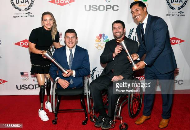 Oksana Masters Brody Roybal Ben Thompson and Rico Roman pose with their awards during the 2019 Team USA Awards at Universal Studios Hollywood on...