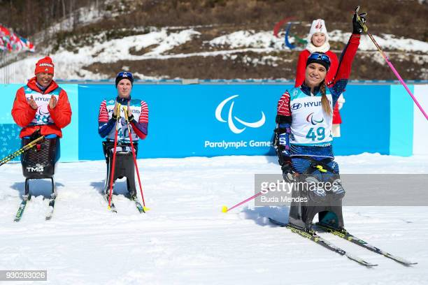 Oksana Masters of the United States celebrates after crossing the finish line in first place in the Women's Cross Country 12km Sitting event at...