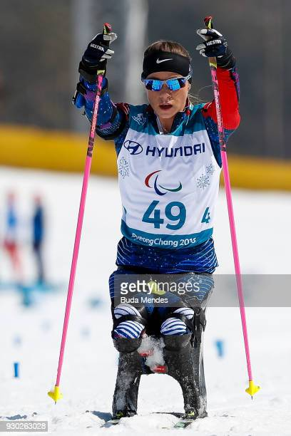 Oksana Masters of the United States crosses the finish line in first place in the Women's Cross Country 12km Sitting event at Alpensia Biathlon...