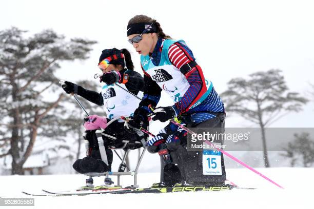 Oksana Masters of the United States right and Akzhana Abdikarimova of Neutral Paralympic Athlete compete in the Women's 125 km Sitting Biathlon at...