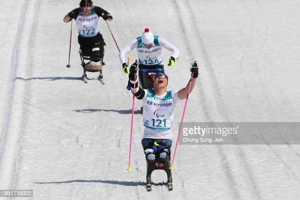 Oksana Masters of United States celebrates in the CrossCountry Skiing Women's 11km Sprint Final Sitting on day five of the PyeongChang 2018...
