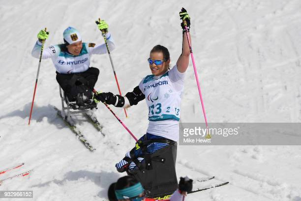 Oksana Masters of USA celebrates after winning gold in the Women's Cross Country Skiing 5km Sitting on day eight of the PyeongChang 2018 Paralympic...