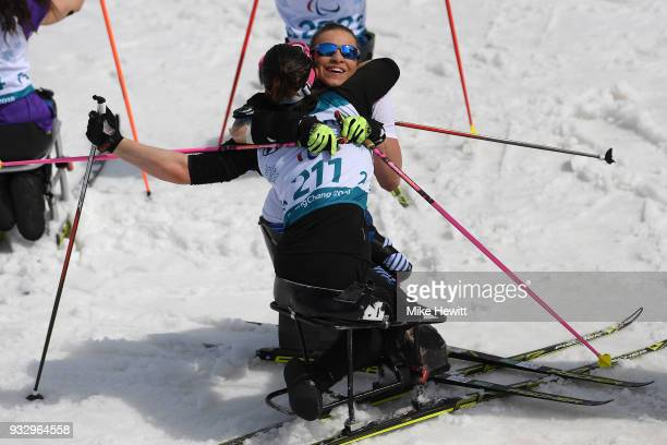 Oksana Masters of USA is congratulated by Bronze medallist and Neutral Paralympic Athlete Marta Zainullina after winning gold in the Women's Cross...