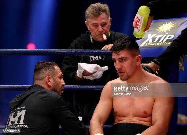 Oktay Urkal coach of Marco Huck of Germany gives instructions to Marco Huck of Germany during the WBC Cruiserweight World Championship title fight at...
