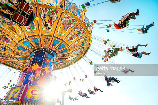 oktoberfest carousel - traveling carnival stock pictures, royalty-free photos & images