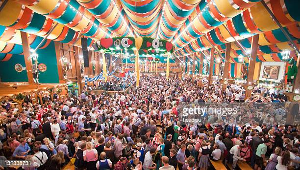 oktoberfest from within  tent - oktoberfest stock pictures, royalty-free photos & images