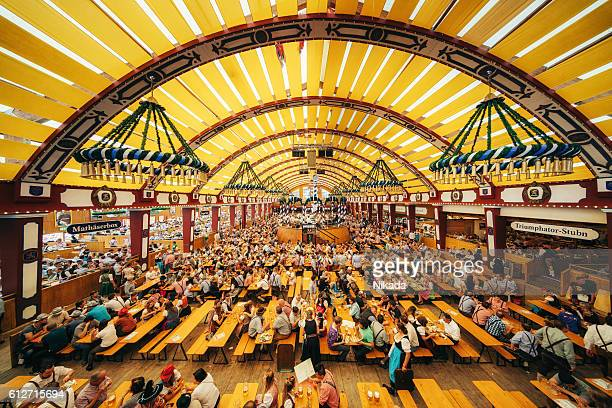 oktoberfest in munich, loewenbraeu brewery's festive tent - oktoberfest stock pictures, royalty-free photos & images