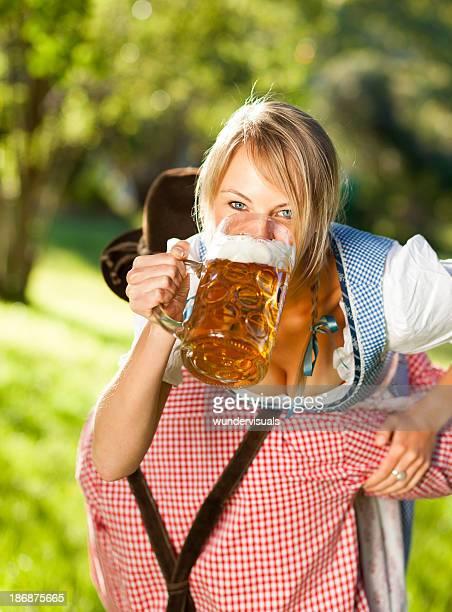 Oktoberfest Man Carrying His Sexy Girlfriend