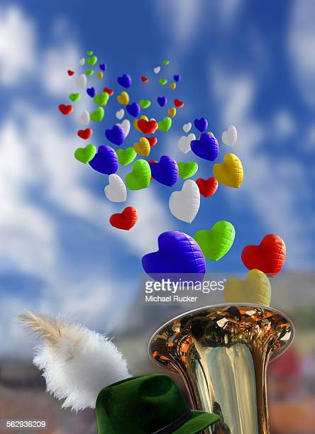 Oktoberfest mood with Bavarian brass band, feathered hat and balloons