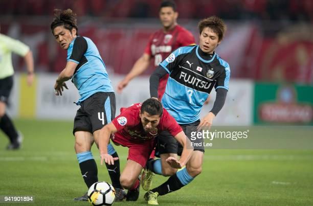 Okubo Yoshito Kurumaya Shintaro of Kawasaki Frontale and Akhmedov of Shanghai SIPG in action during the 2018 AFC Champions League match between...