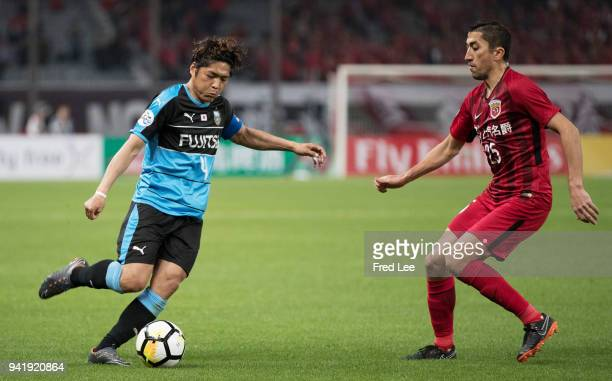 Okubo Yoshito of Kawasaki Frontale and Akhmedov of Shanghai SIPG in action during the 2018 AFC Champions League match between Shanghai SIPG and...