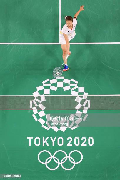 Okuhara Nozomi of Team Japan competes against Yvonne Li of Team Germany during a Women's Singles Group E match on day two of the Tokyo 2020 Olympic...