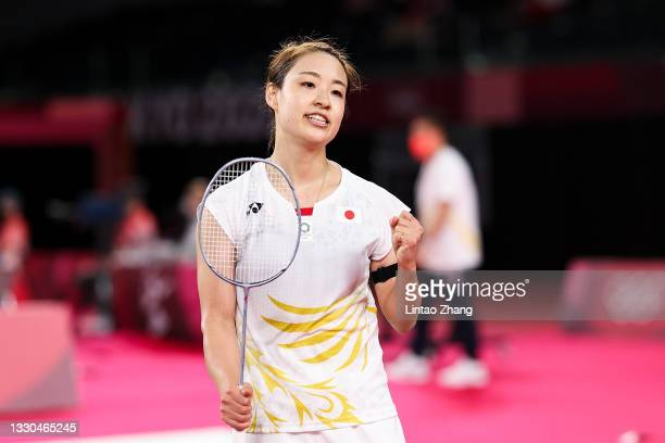 Okuhara Nozomi of Team Japan reacts as she wins against Yvonne Li of Team Germany during a Women's Singles Group E match on day two of the Tokyo 2020...