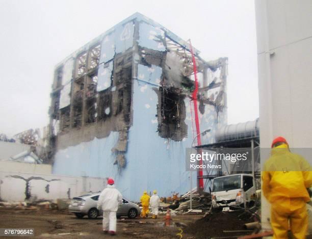 Okuma Japan Supplied photo shows an effort to cool down the No4 reactor of the crippled Fukushima Daiichi Nuclear Power Station in Fukushima...