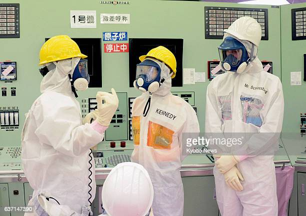 Okuma Japan US Ambassador to Japan Caroline Kennedy and her son Jack Schlossberg wearing protective suits and masks are briefed during their visit to...