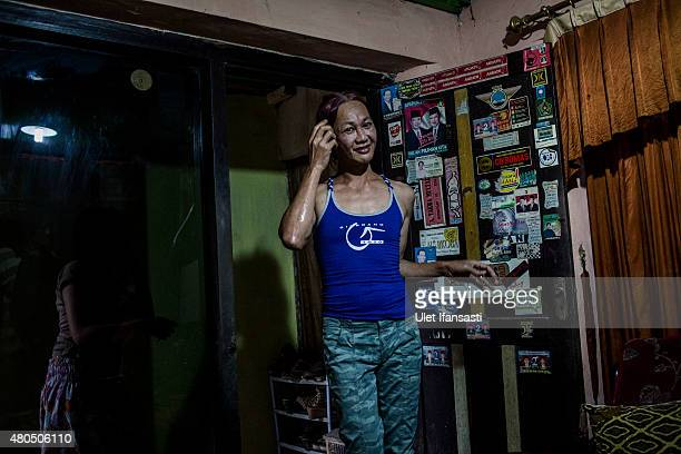 Oky, a member of a Pesantren boarding school, Al-Fatah, for transgender people known as 'waria' is seen attend during Ramadan on July 12, 2015 in...