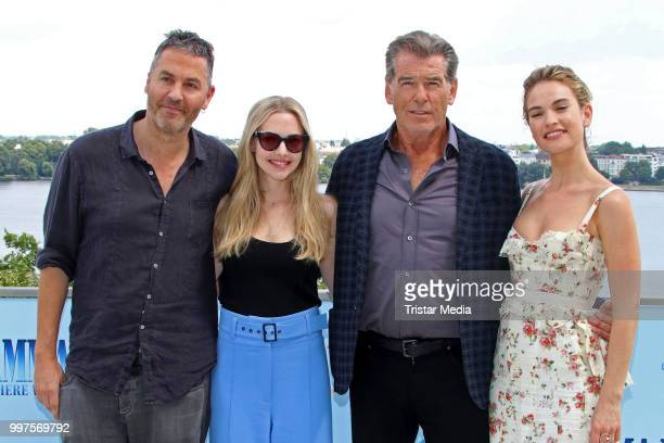 Ol Parker Amanda Seyfried Pierce Brosnan and Lily James during the Mamma Mia Here we go again' Musical Photo Call on July 12 2018 in Hamburg Germany