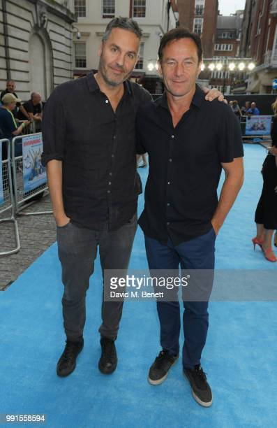 """Ol Parker and Jason Isaacs attend the UK Premiere of """"Swimming With Men' at The Curzon Mayfair on July 4, 2018 in London, England."""