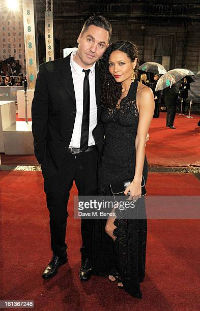 Ol Parker and Thandie Newton arrive at the EE British Academy Film Awards at the Royal Opera House on February 10 2013 in London England