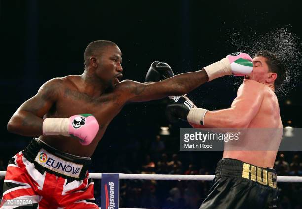 Ola Afolabi of Great Britain exchange punches with Marco Huck of Germany during their WBO Cruiserweight title fight at Max Schmeling Halle on June 8,...