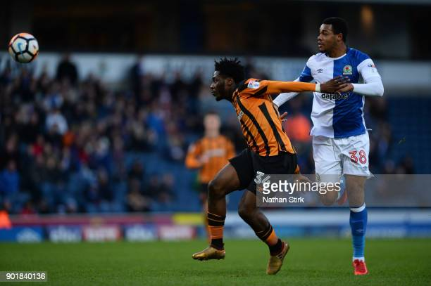 Ola Aina of Hull City and Joe Nuttall of Blackburn Rovers in action during The Emirates FA Cup Third Round match between Blackburn Rovers and Hull...