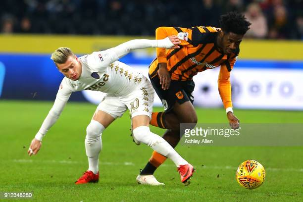 Ola Aina of Hull City moves the ball past Ezgjan Alioski of Leeds United during the Sky Bet Championship match between Hull City and Leeds United at...