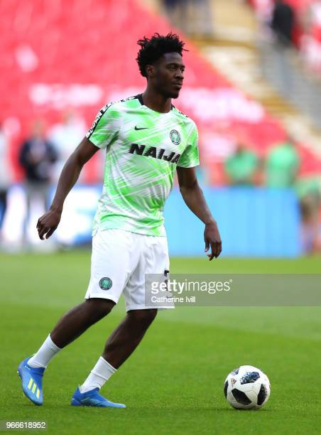 Ola Aina of Nigeria warms up before the International Friendly match between England and Nigeria at Wembley Stadium on June 2, 2018 in London,...