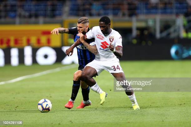 Ola Aina of Torino FC and Mauro Icardi of Internazionale Fc in action during the Serie A football match between FC Internazionale and Torino Fc