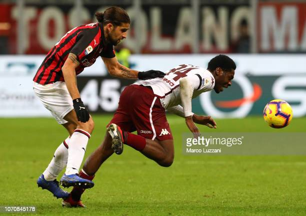 Ola Aina of Torino FC competes for the ball with Ricardo Rodriguez of AC Milan during the Serie A match between AC Milan and Torino FC at Stadio...