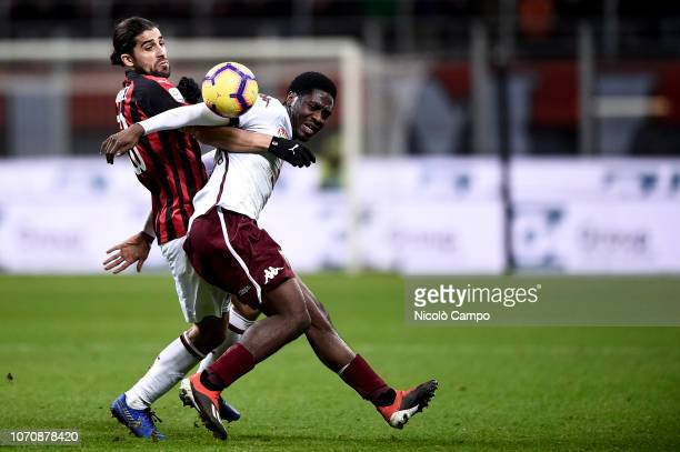 Ola Aina of Torino FC competes for the ball with Ricardo Rodriguez of AC Milan during the Serie A football match between AC Milan and Torino FC The...