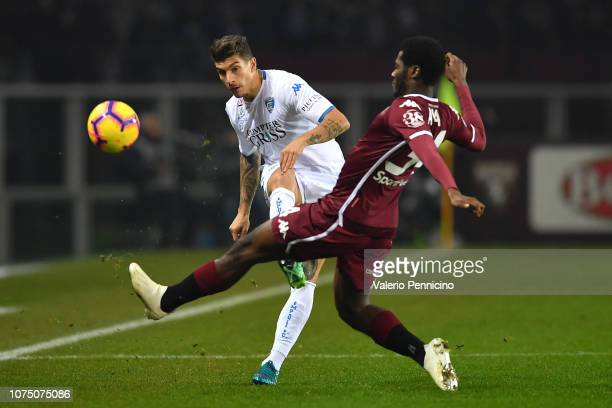 Ola Aina of Torino FC competes with Giovanni Di Lorenzo of Empoli during the Serie A match between Torino FC and Empoli at Stadio Olimpico di Torino...