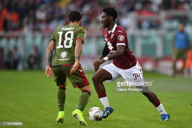 Ola Aina of Torino FC in action against Nahitan Nandez of Cagliari Calcio during the Serie A match between Torino FC and Cagliari Calcio at Stadio...