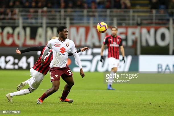Ola Aina of Torino FC in action during the Serie A football match between Ac Milan and Torino Fc The match end in a tie 00